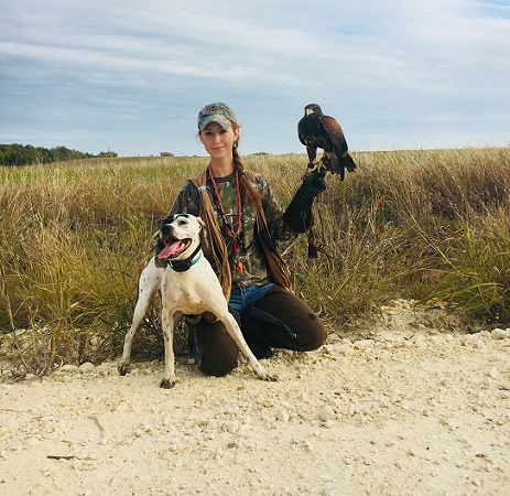 Mallory Roelke with Harris's hawk and pointer