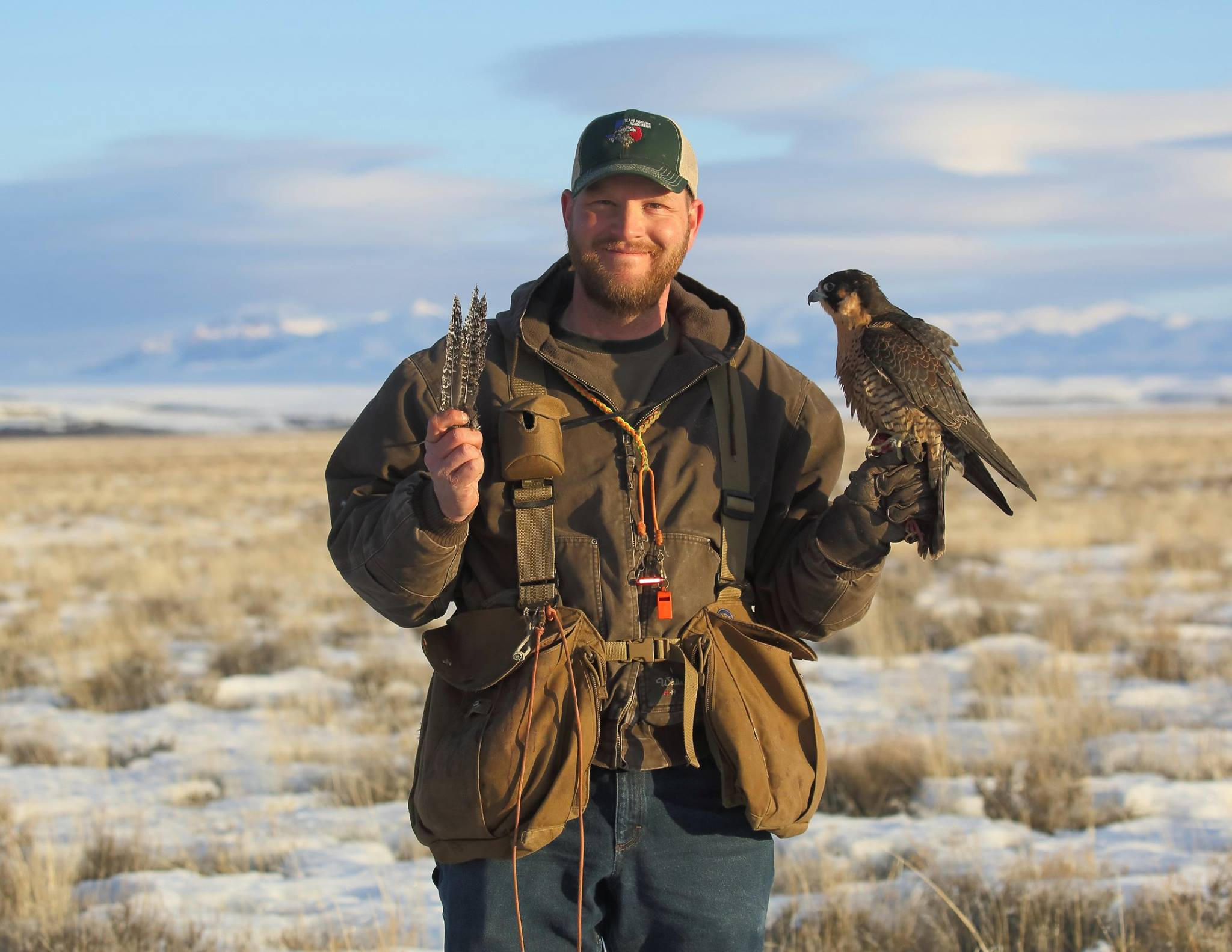 Corey Roelke with passage peregrine and grouse feathers